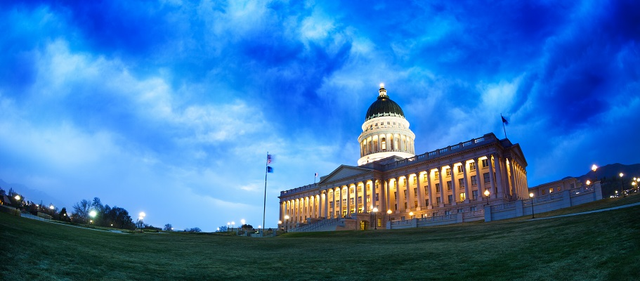 Utah Capitol Building with lights on as the sun sets