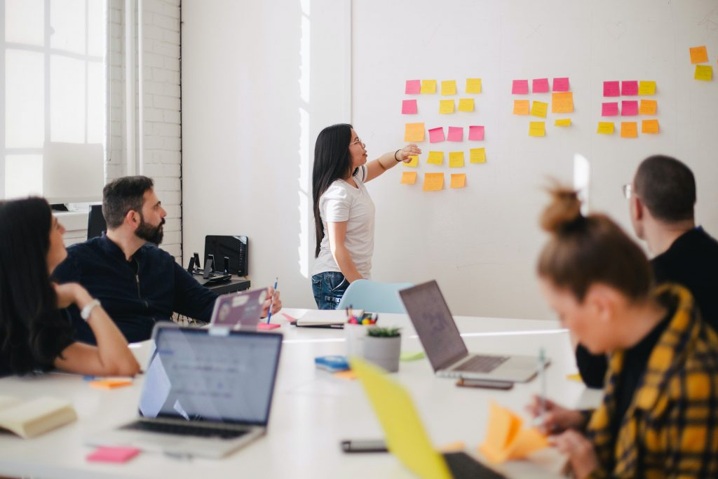 Group of employees in conference room problem solving