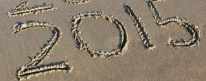 The year 2015 written in the sand
